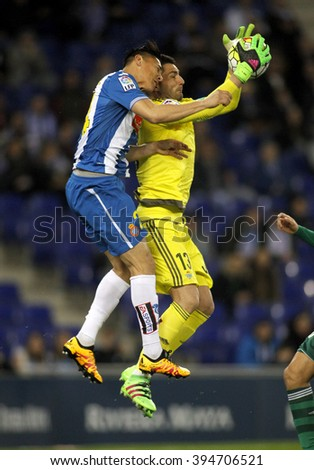 BARCELONA - MARCH, 3: Oscar Duarte(L) of Espanyol and Antonio Adan(R) of Real Betis fighting during a Spanish League match at the Power8 stadium on March 3, 2016 in Barcelona, Spain - stock photo