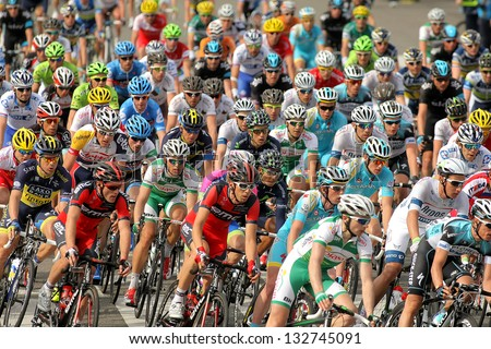 BARCELONA - MARCH, 24: Pack of the cyclists ride during the Tour of Catalonia cycling race through the streets of Monjuich mountain in Barcelona on March 24, 2013 - stock photo