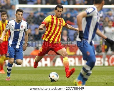 BARCELONA - MARCH, 29: Sergio Busquets of FC Barcelona in action during a Spanish League match against RCD Espanyol at the Estadi Cornella on March 29, 2014 in Barcelona, Spain - stock photo