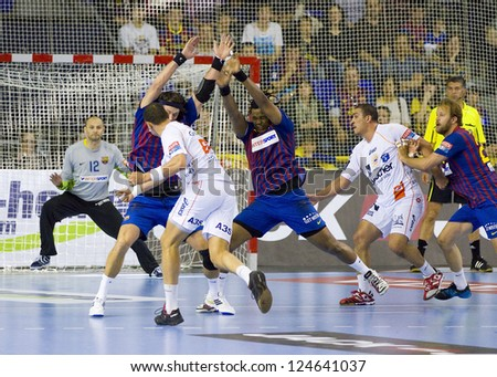 BARCELONA - MARCH 25: Some players in action during EHF Champions League match between FC Barcelona and Montpellier, final score 36-20, on March 25, 2012, in Palau Blaugrana, Barcelona, Spain.