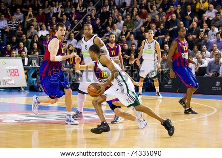 BARCELONA - MARCH 24: Some players in action during the Euroleague basketball match between Barcelona and Panathinaikos, 71-75, on March 24, 2011 in Barcelona, Spain. - stock photo