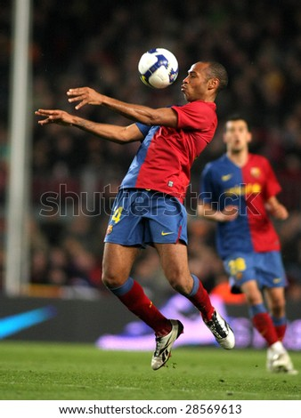 BARCELONA - MARCH 7: Thierry Henry of FC Barcelona controls the ball during Spanish soccer league match between FC Barcelona and Athletic Bilbao at Nou Camp stadium March 7, 2009 in Barcelona, Spain. - stock photo