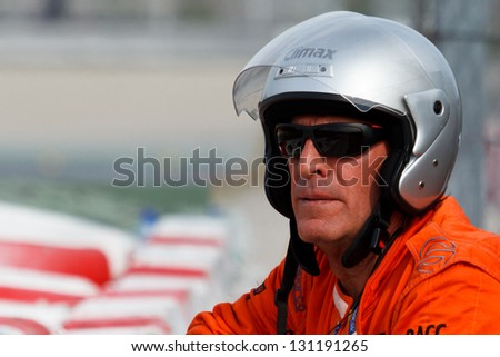 BARCELONA - MARCH 3: Track Marshal watches the track during Formula One Test Days at Catalunya circuit on March 3, 2013 in Barcelona, Spain. - stock photo