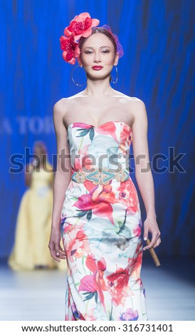 BARCELONA - MAY 07: a model walks on the Ana Torres bridal collection 2016 catwalk during the Barcelona Bridal Week runway on May 07, 2015 in Barcelona, Spain.  - stock photo