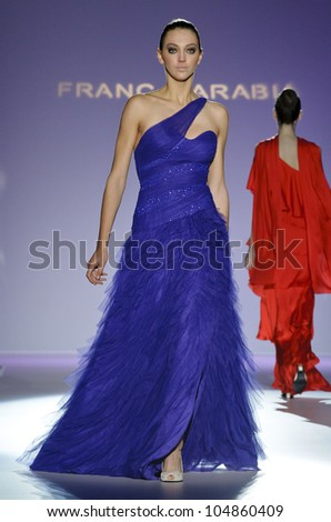 BARCELONA - MAY 10: A model walks on the Franc Sarabia catwalk during the Barcelona Bridal Week runway on May 10, 2012 in Barcelona, Spain.