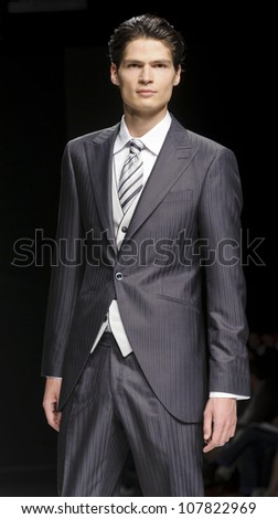 BARCELONA - MAY 11: A model walks on the Fuentecapala catwalk during the Barcelona Bridal Week runway on May 11, 2012 in Barcelona, Spain.