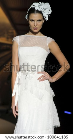 BARCELONA - MAY 11: A model walks on the Jesus Peiro catwalk during the Barcelona Bridal Week runway on May 11, 2011 in Barcelona, Spain. - stock photo