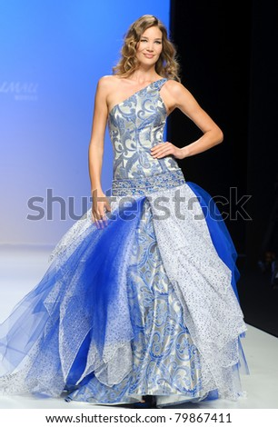 BARCELONA - MAY 12: A model walks on the Jordi Dalmau catwalk during the Barcelona Bridal Week runway on May 12, 2011 in Barcelona. - stock photo