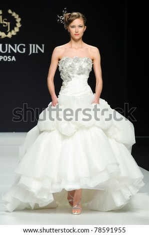 BARCELONA - MAY 12: A model walks on the Lee Seung Jin catwalk during the Barcelona Bridal Week runway on May 12, 2011 in Barcelona.