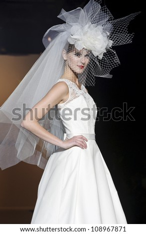 BARCELONA - MAY 10: A model walks on the Patricia Avendano catwalk during the Barcelona Bridal Week runway on May 10, 2012 in Barcelona, Spain.