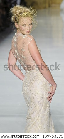 BARCELONA - MAY 03: A model walks on the Pronovias catwalk during the Barcelona Bridal Week runway on May 03, 2013 in Barcelona, Spain. - stock photo