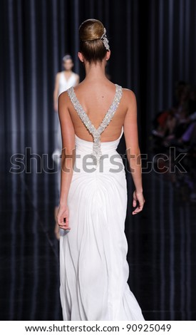 BARCELONA - MAY 13: A model walks on the Pronovias catwalk during the Barcelona Bridal Week runway on May 13, 2011 in Barcelona. - stock photo