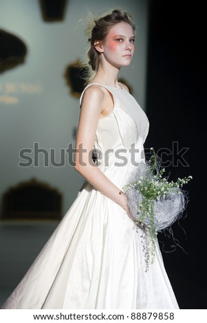 BARCELONA - MAY 12: A model walks on the Raimon Bundo catwalk during the Barcelona Bridal Week runway on May 12, 2011 in Barcelona.