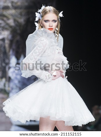 BARCELONA - MAY 07: a model walks on the Yolan Cris bridal collection 2015 catwalk during the Barcelona Bridal Week runway on May 07, 2014 in Barcelona, Spain.  - stock photo