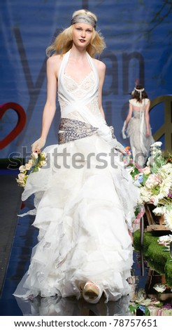 BARCELONA - MAY 11: A model walks on the Yolan Cris catwalk during the Barcelona Bridal Week runway on May 11, 2011 in Barcelona, Spain. - stock photo