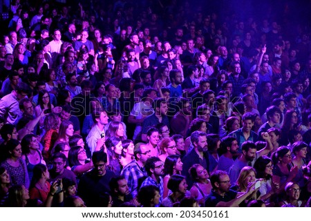 BARCELONA - MAY 16: A view from above of people clapping in a concert at Razzmatazz discotheque on May 16, 2014 in Barcelona, Spain. - stock photo