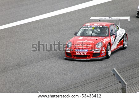 "BARCELONA- MAY 9: Alessandro Zampedri of Lechner Racing in action during Porsche Mobil 1 Supercup at autodrome ""Catalunya Montmello"" on May 9, 2010 in Barcelona. Zampedri not finished - stock photo"