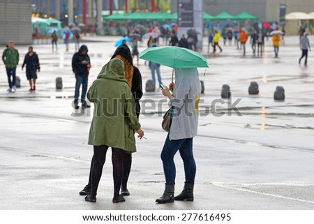 BARCELONA - MAY 30: Audience with umbrellas at Heineken Primavera Sound 2014 Festival (PS14) on May 30, 2014 in Barcelona, Spain.