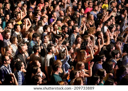 BARCELONA - MAY 16: Crowd in a concert at Razzmatazz discotheque on May 16, 2014 in Barcelona, Spain. - stock photo