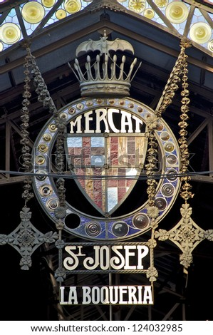 "BARCELONA - MAY 31. Emblem at the entrance to the public market ""La Boqueria Sant Josep"" on May 31, 2012 in Barcelona. The market hall is one of the most visited tourist attractions in Barcelona"