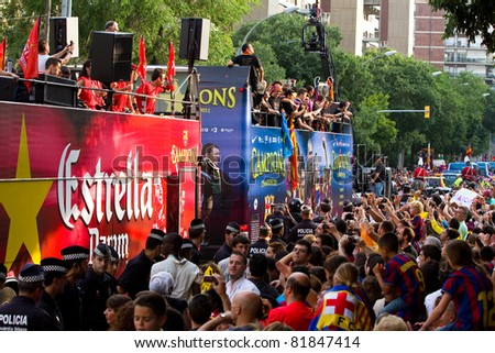 BARCELONA - MAY 29: FC Barcelona players and supporters celebrate the European Champions League and Spanish League trophies, on May 29, 2011 in Barcelona, Spain. - stock photo