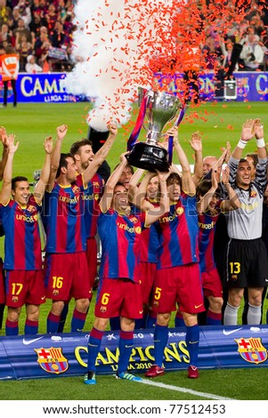 BARCELONA - MAY 15: FC Barcelona players receive the cup and celebrate the Spanish League Championship victory in Camp Nou stadium, on May 15, 2011 in Barcelona, Spain. - stock photo