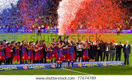 BARCELONA - MAY 15: FC Barcelona players receiving the cup and celebrating the Spanish League Championship victory in Camp Nou stadium, on May 15, 2011 in Barcelona, Spain. - stock photo