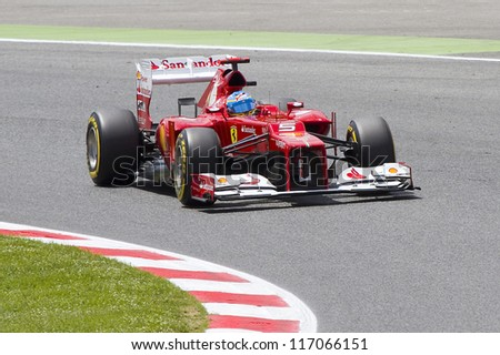 BARCELONA - MAY 12: Fernando Alonso of Ferrari F1 team racing at Qualifying Session of Formula One Spanish Grand Prix at Catalunya circuit, on May 12, 2012 in Barcelona, Spain. - stock photo