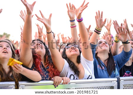 BARCELONA - MAY 23: Girls from the audience in front of the stage, cheering on their idols at the Primavera Pop Festival of Badalona on May 18, 2014 in Barcelona, Spain. - stock photo