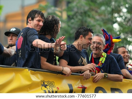 BARCELONA - MAY 13: Leo Messi(L), Gabi Milito(C) and Xavi Hernandez(R) on the Barcelona's players bus in the celebration after winning the Spanish League title in Barcelona on May 13, 2011 in Barcelona, Spain - stock photo