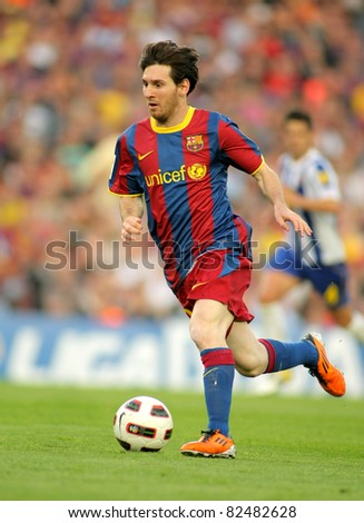 BARCELONA - MAY 8: Leo Messi of FC Barcelona during the match between FC Barcelona and RCD Espanyol at the Nou Camp Stadium on May 8, 2011 in Barcelona, Spain - stock photo