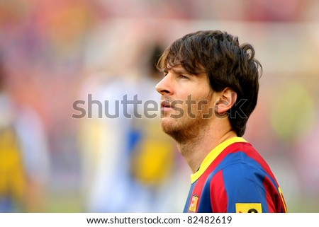 BARCELONA - MAY 8: Leo Messi of FC Barcelona watch to the scoreboard during the match between FC Barcelona and RCD Espanyol at the Nou Camp Stadium on May 8, 2011 in Barcelona, Spain - stock photo
