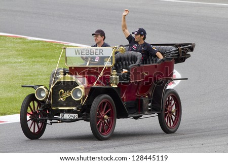 BARCELONA - MAY 13: Mark Webber of Red Bull driving a Cadillac classic car before the Formula One Spanish Grand Prix, on May 13, 2012 in Barcelona, Catalonia, Spain. The winner was Pastor Maldonado. - stock photo