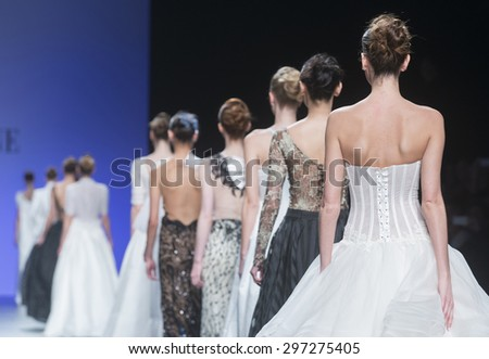 BARCELONA - MAY 07: models walking on the Cymbeline bridal collection 2016 catwalk during the Barcelona Bridal Week runway on May 07, 2015 in Barcelona, Spain.  - stock photo