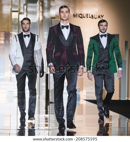 BARCELONA - MAY 09: models walking on the Miquel Suay bridal collection 2015 catwalk during the Barcelona Bridal Week runway on May 09, 2014 in Barcelona, Spain.  - stock photo