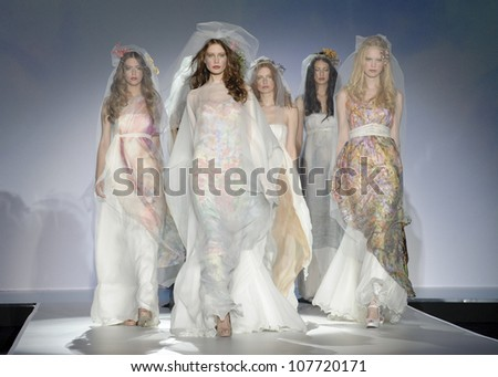 BARCELONA - MAY 10: Models walking on the Raimon Bundo catwalk during the Barcelona Bridal Week runway on May 10, 2012 in Barcelona. - stock photo