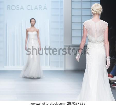 BARCELONA - MAY 05: models walking on the Rosa Clara bridal collection 2016 catwalk during the Barcelona Bridal Week runway on May 05, 2015 in Barcelona, Spain.  - stock photo