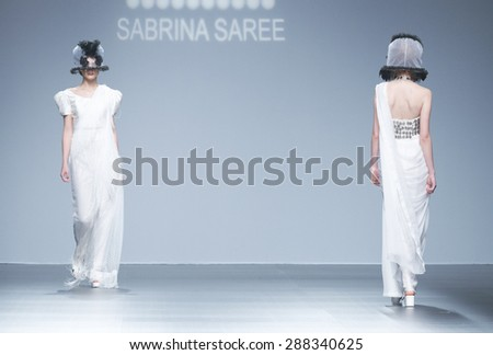 BARCELONA - MAY 06: models walking on the Sabrina Saree bridal collection 2016 catwalk during the Barcelona Bridal Week runway on May 06, 2015 in Barcelona, Spain.  - stock photo