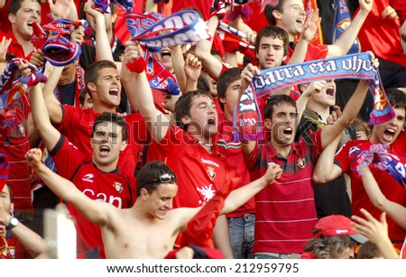 BARCELONA - MAY, 11: Osasuna supporters celebrating goal during a Spanish league match against RCD Espanyol at the Estadi Cornella on May 11, 2014 in Barcelona, Spain - stock photo