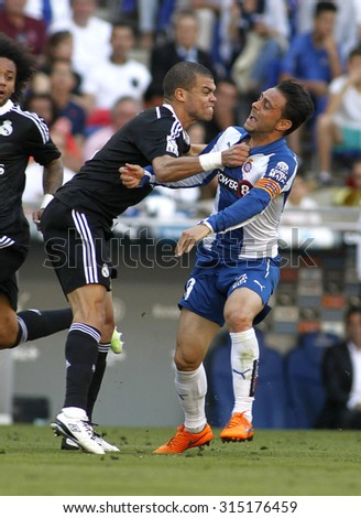 BARCELONA - MAY, 2015: Pepe(L) of Real Madrid fight with Sergio Garcia(R) Espanyol fight during a Spanish League match against RCD Espanyol at the Power8 stadium on Maig 17 2015 in Barcelona Spain - stock photo