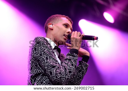 BARCELONA - MAY 28: Stromae, Belgian singer who plays House, New Beat and electronic music, performs at Heineken Primavera Sound 2014 Festival (PS14) on May 28, 2014 in Barcelona, Spain.