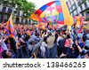 BARCELONA - MAY 13: Thousands of supporters of F.C Barcelona, celebrate with flags the Spanish League victory in the famous street Rambla Catalunya on May 13, 2013 in Barcelona, Spain. - stock photo