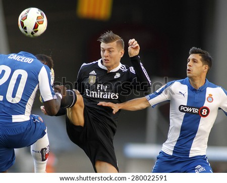 BARCELONA-MAY, 17: Toni Kroos(C) of Real Madrid between Caidedo(L) and Javi Lopez(R) of Espanyol during a League match against RCD Espanyol at the Power8 stadium on Maig 17 2015 in Barcelona Spain - stock photo
