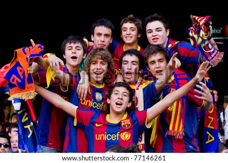 BARCELONA - MAY 13: Unidentified FC Barcelona supporters celebrate the Spanish League Championship victory in Camp Nou stadium on May 13, 2011 in Barcelona, Spain. - stock photo