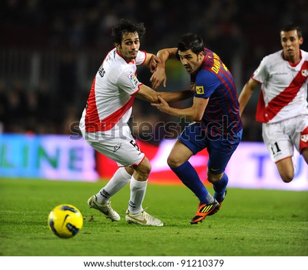 BARCELONA - NOV 29: Alejandro Arribas of Rayo Vallecano vie with David Villa of FC Barcelona during the spanish league match at the Nou Camp Stadium on November 29, 2011 in Barcelona, Spain - stock photo