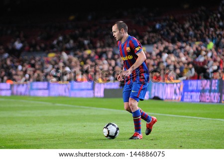 BARCELONA - NOV 10: Andres Iniesta, F.C Barcelona player, plays against Cultural Leonesa at the Camp Nou Stadium on the Spanish Cup (Copa del Rey) on November 10, 2009 in Barcelona, Spain. - stock photo