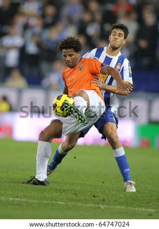 BARCELONA - NOV 6: Eliseu of Malaga in action during spanish league match between Espanyol and Malaga CF at the Estadi Cornella on November 6, 2010 in Barcelona, Spain