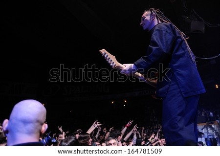 BARCELONA - NOV 25: Five Finger Death Punch (5FDP), heavy metal band, performs at Pavello Olimpic de Badalona stage on November 25, 2013 in Barcelona, Spain. - stock photo