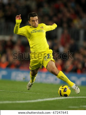BARCELONA - NOV 13: Giuseppe Rossi of Villarreal in action during a Spanish League match between FC Barcelona and Villarreal CF at the Nou Camp Stadium on November 13, 2010 in Barcelona, Spain - stock photo