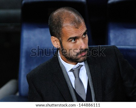 BARCELONA - NOV 10: Josep Pep Guardiola sitting on the bench  at the Camp Nou Stadium on the Spanish Cup (Copa del Rey) match between Barcelona and Cultural on November 10, 2009 in Barcelona, Spain.